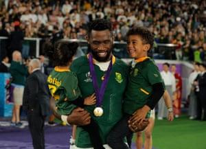 South African captain Siya Kolisi celebrates with his children.