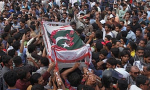 Mourners carry the coffin of activist Khurram Zaki