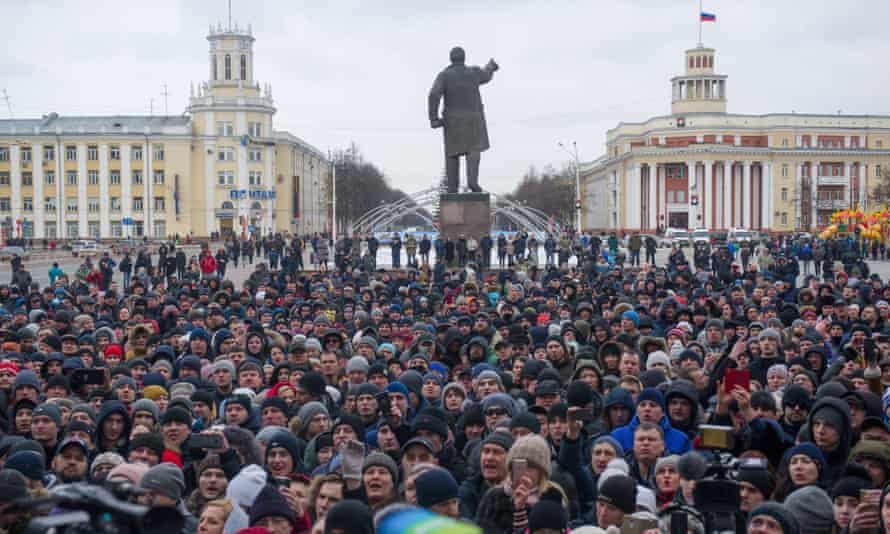 People rally in central Kemerovo in the aftermath of the fire