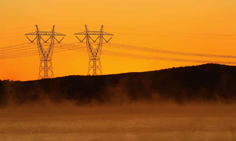 Power lines in early morning fog