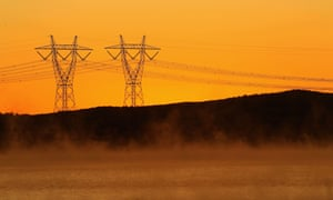 Power lines in early morning fog.