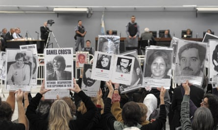 People hold portraits of missing relatives in 2010.