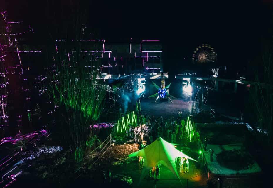 Lights play on buildings in Valery Korshunov's atmospheric installation.