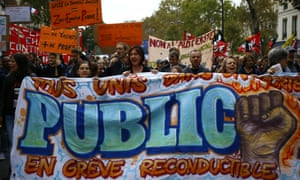 Demonstrators carry a banner reading 'Public sector on strike' during a protest in Paris.