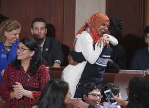 Ilhan Omar embraces her son after she was sworn in by Nancy Pelosi.