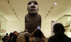 An ancestor figure 'moai' known as Hoa Hakananai'a stands at the entrance to the Wellcome gallery in the British Museum in London.