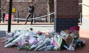 Flowers placed in Reading town centre, the scene of a multiple stabbing attack which took place on Saturday, leaving three people dead and another three seriously injured