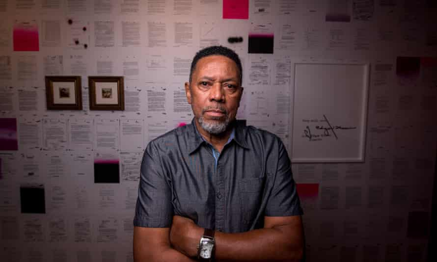 Rodney Barnette, who opened the Black Panthers' Compton office, poses for a photo in front of an art exhibit about the group created by his daughter.