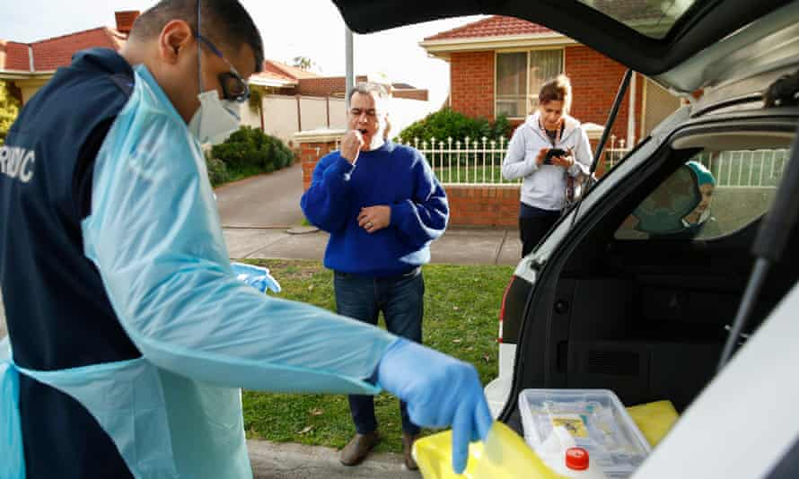 Paramedics perform Covid-19 tests on the street in the hotspot Melbourne suburb of Broadmeadows on Thursday.