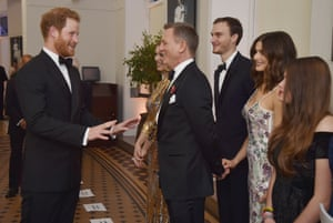 Prince Harry jokes with Daniel Craig, Rachel Weisz and other cast member
