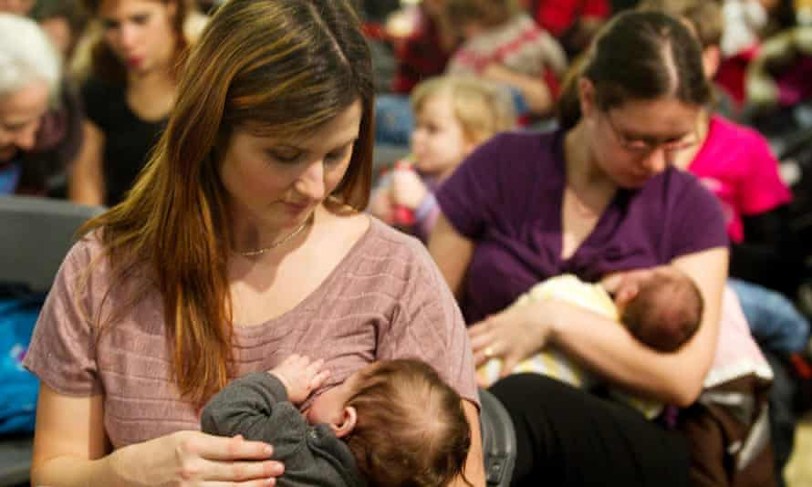Mothers breastfeed their children in Montreal.