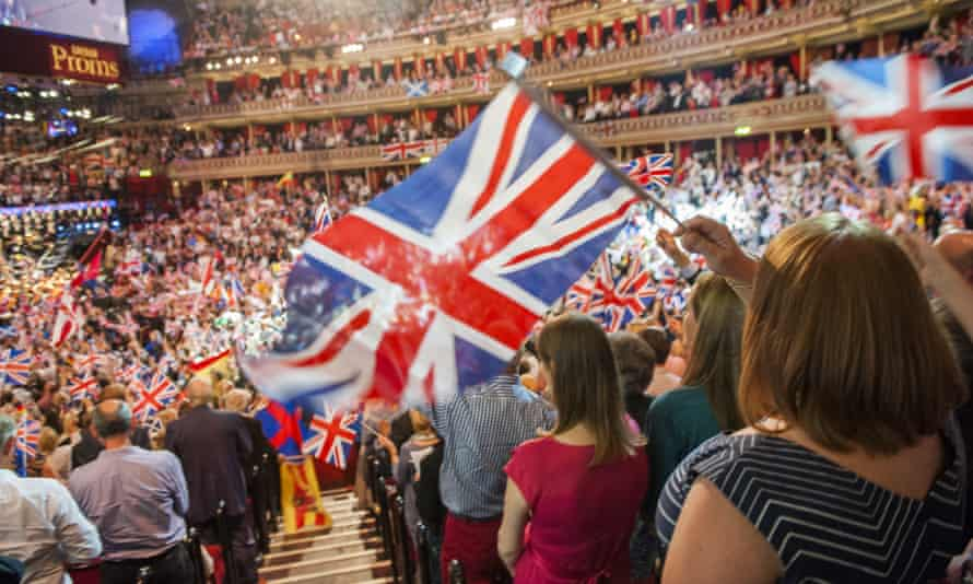 Audience standing and flag-waving at the Last Night of the Proms