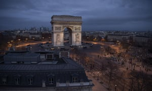 As dawn begins to break, a ring of police vehicles surround the Arc de Triomphe