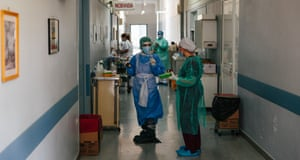 Medical and catering staff throng the busy corridors of the hospital