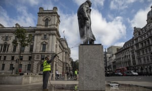 A statue of Winston Churchill is cleaned in London after being daubed with graffiti