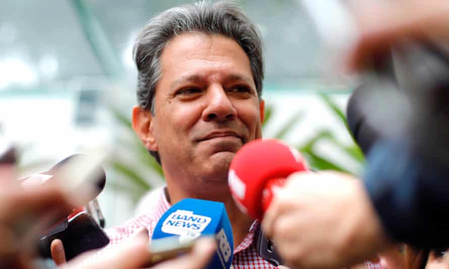 Brazilian socialist presidential candidate Fernando Haddad talks to media after casting his ballot at a polling station in Sao Paulo, Brazil, on Sunday.