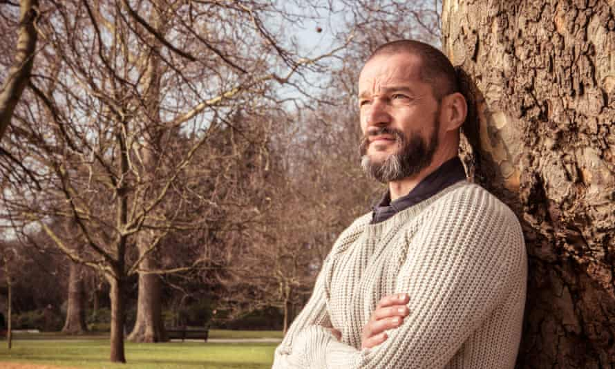 Fred Sirieix leaning against a tree