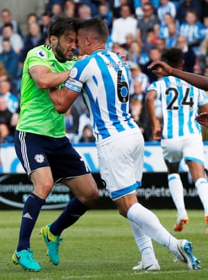 Huddersfield Town's Jonathan Hogg head butts Cardiff City's Harry Arter resulting in referee Michael Oliver showing a red card during the goalless draw at the John Smith's Stadium.