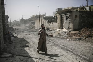 Mosul, Iraq A resident shouts for help