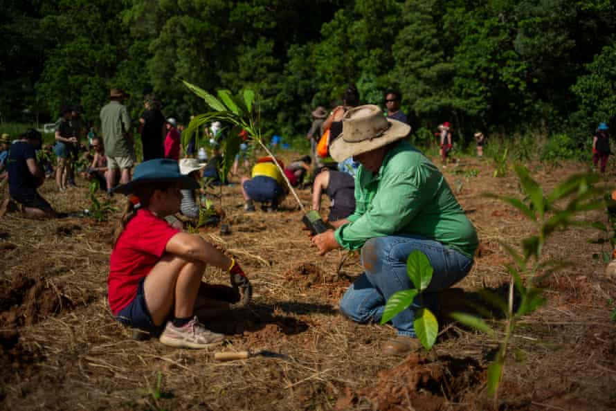 Local sugar cane grower Clint Reynolds and his daughter attend the annual Tree Planting Day on the Night Wings' property.