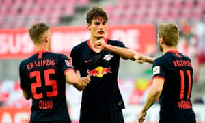 Leipzig's Czech forward Patrik Schick (C) celebrates with teammates.