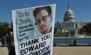 Demonstrators hold placards supporting former US intelligence analyst Edward Snowden during a protest against government surveillance in Washington DC.