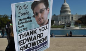 A protester holds a placard thanking Edward Snowden for exposing data collection