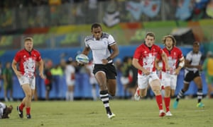 Leone Nakarawa charges towards the try line for Fiji's third try.