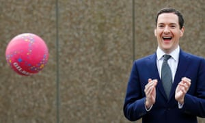 George Osborne watches netball at a school in Garforth, Leeds, the day after his budget