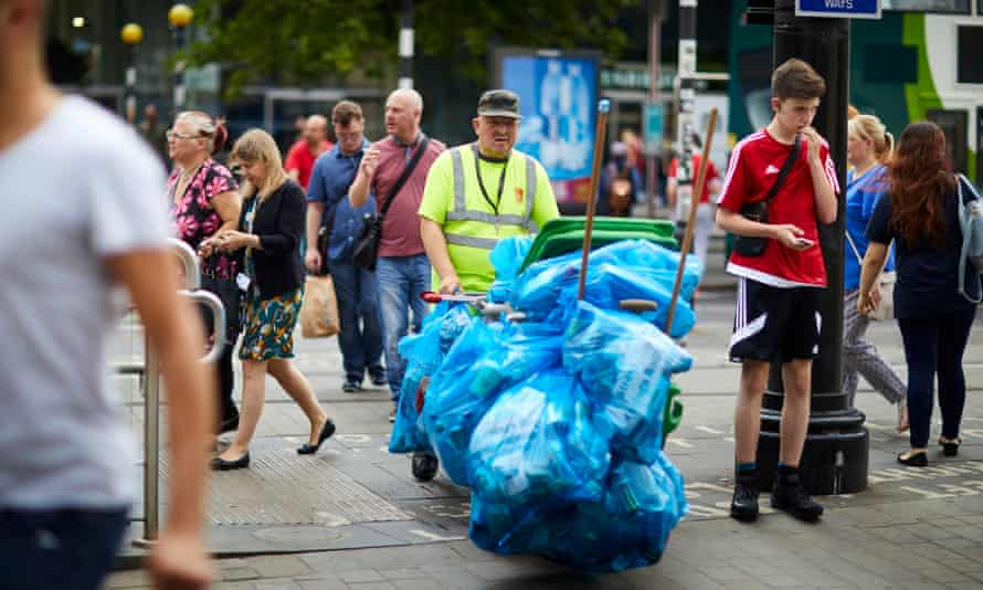 A refuse collector working in Piccadilly Gardens, Manchester