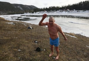 Vladimir Khokhlov, 71, warms up after taking a dip in the icy water of the Mana river outside the Siberian city of Krasnoyarsk. 'I can't live without bathing daily in cold water, it's like a drug. If there's no river nearby I have to find another way to pour cold water over myself from head to foot'