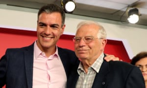 Spanish acting prime minister Pedro Sanchez (L) embraces Josep Borrell (R), acting Spanish foreign minister, after an election victory for their Socialist party on Sunday.