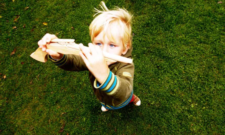 Blond Boy holding wooden gun
