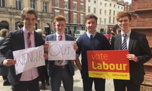 A Level students Jacob (left), Josh (second left) and Ed (right), and Ben (second right), a law student at Warwick, who held up a Wenger Out banner behind Labour leader and Arsenal fan Jeremy Corbyn as he spoke to supporters outside the Town Hall in Leamington Spa.