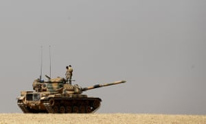 Turkish soldiers on their tank as they prepare for a military operation at the Syrian border against Islamic State.