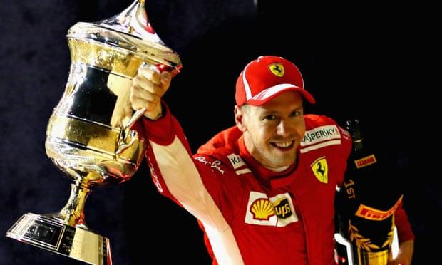 Race winner Sebastian Vettel celebrates on the podium.