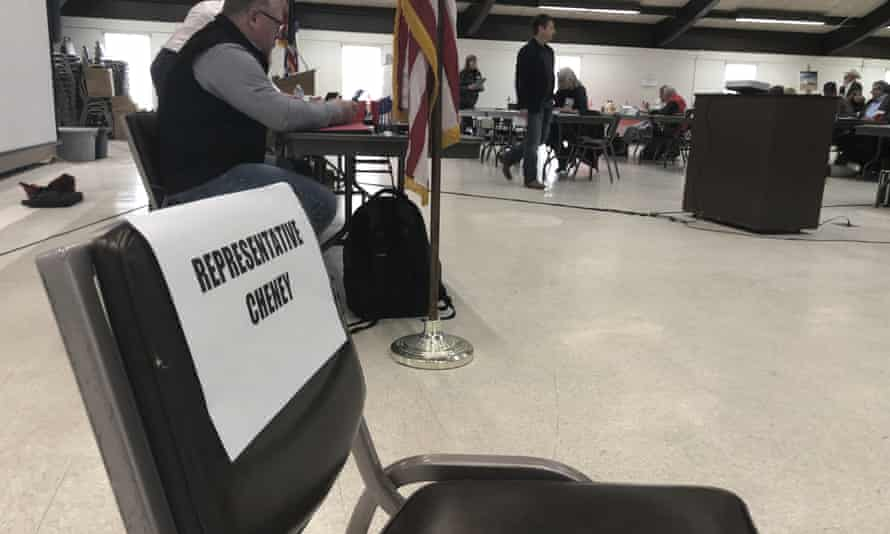 """An empty chair labeled """"Representative Cheney"""" sits in front of a meeting room in Rawlins, Wyoming., Saturday, February 6, 2021"""
