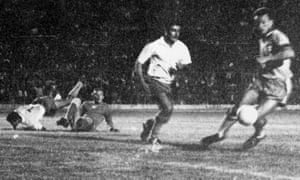 Costa Rica's Jorge 'Cuty' Monge (white shirt) challenges the Brazil defender Airton while Guillermo 'Memo' Valenciano and the goalkeeper Irno try to regain their feet.