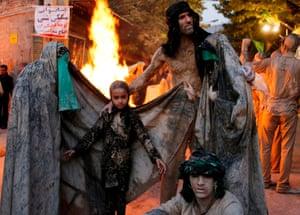 Gathering round bonfire