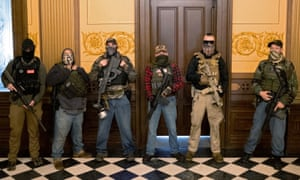A militia group occupies the Michigan capitol in April, including Pete Musico, right, who was charged over a plot to kidnap governor Gretchen Whitmer.