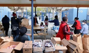 Families arrive at West Oakland middle school to pick up grab and go meals during the Oakland unified school district shutdown.