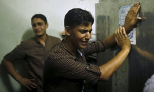 Friends of Mohammed Al-Masri mourn at a morgue in northern Gaza Strip.