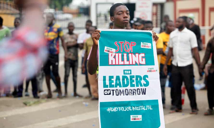 A protester holds a banner that says 'Stop killing the leaders of tomorrow' in Lagos