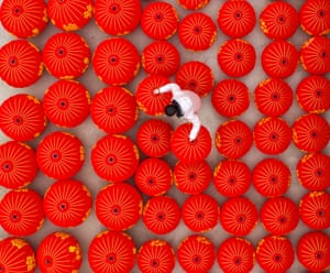 Employees work overtime to make red lanterns and Chinese knots in Sihong County, Jiangsu Province, China.