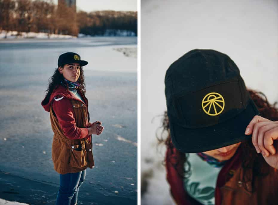 """Saya Ameli's hat which has the """"Sunrise Movement"""" logo which is about pursuing the green new deal. Saya Ameli is wearing her hat at Leverett Pond in Brookline, Massachusetts. Credit: Tony Luong for The Guardian"""
