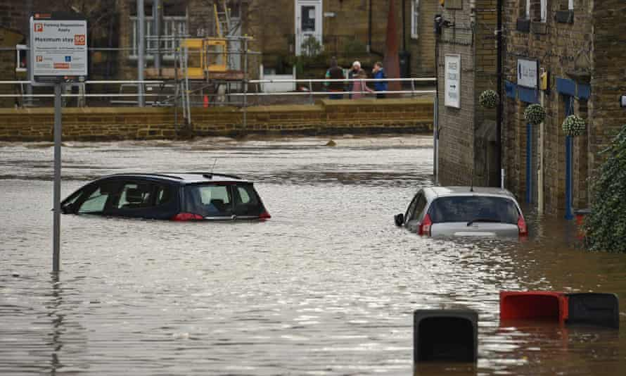 Flood water covers roads and car parks in Mytholmroyd, West Yorkshire.