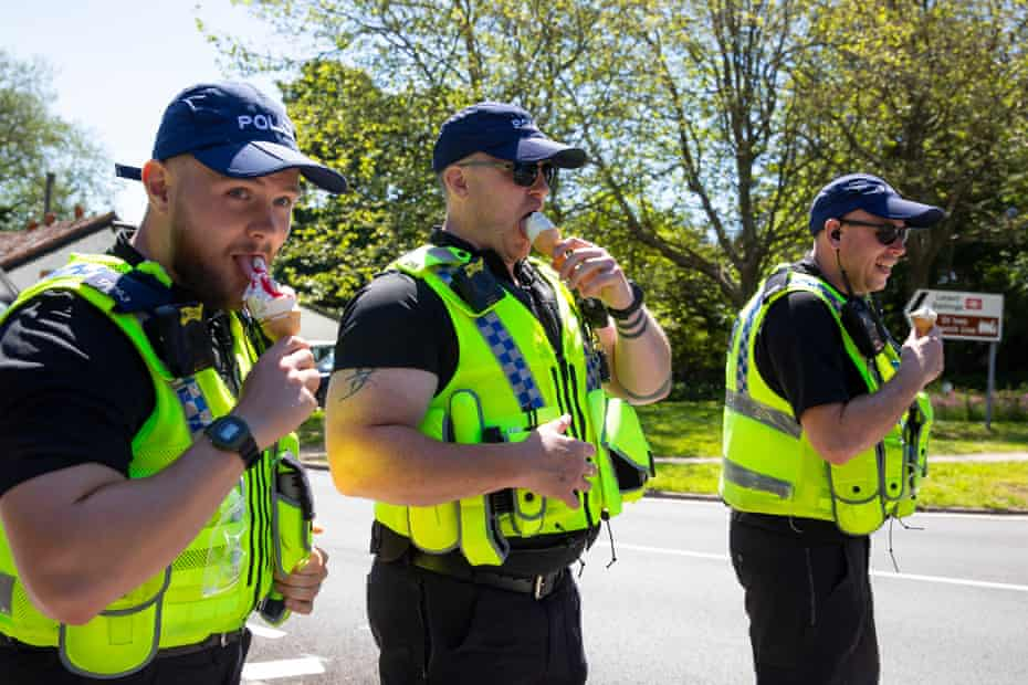 Officers enjoying ice creams during the sweltering heat on Sunday.