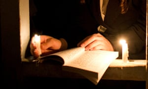 Lighting the way … reading by candlelight.