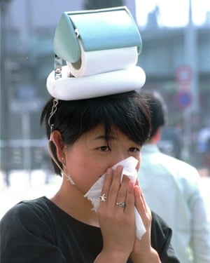 "A woman wearing a ""hay fever hat"" created by the Japanese inventor Kenji Kawakami."
