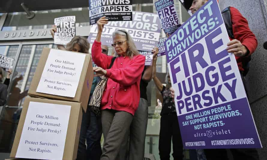Activists hold a rally before delivering more than a million signatures to the California commission on judicial performance calling for the removal of Judge Aaron Persky from the bench.